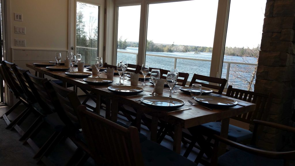 Grand dining room table that sits more than 15 people with view over lake