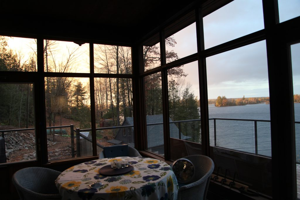 Screened porch looking out to sunset view
